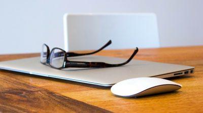 desk apple laptop glasses